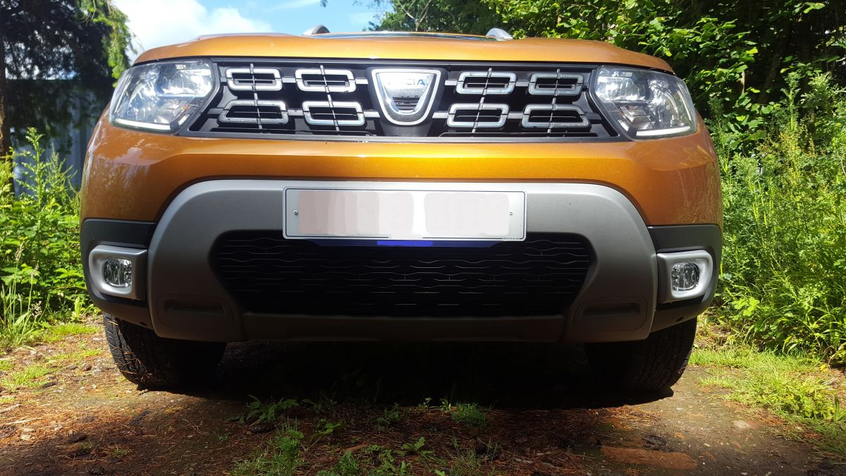 Duster II fog light trim both fitted